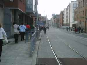 Commuters get off the luas and walk